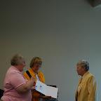 Alice Hix, Jean Gleaves present books to Mary Kegley