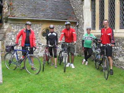 5 cyclists outside church