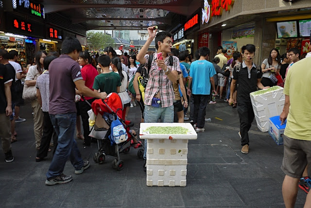 man selling cucumber slicers at Dongmen in Shenzhen, China