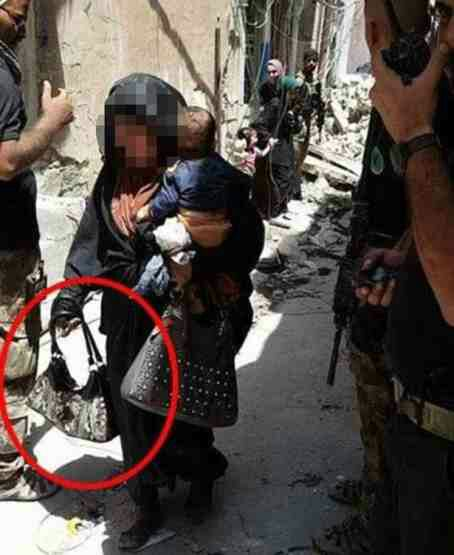 Female 'suicide bomber' cradling baby pictured moments before 'blowing both of them up
