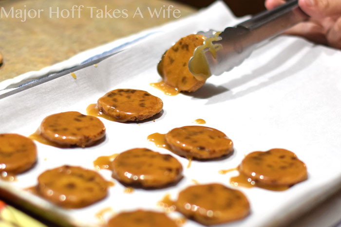 Allowing butterscotch dipped cookies to cool