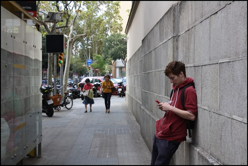 Man with phone in Barcelona