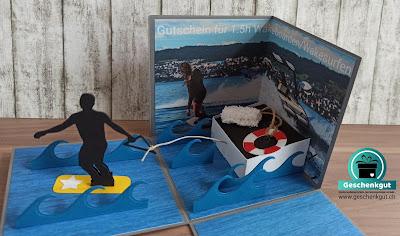 Geschenkbox Explosionsbox Überraschungsbox Wakesurf Wakeboard Wasserski Gutschein