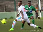 La RDC (blanc) contre  la Sierra Leone (vert)  le 19/11/2014 au stade Tata Raphaël à Kinshasa lors du match de la 6e et dernière journée des éliminatoires de la Can 2015-Guinée Equatoriale, score: 1-3. Radio Okapi/Ph. John Bompengo