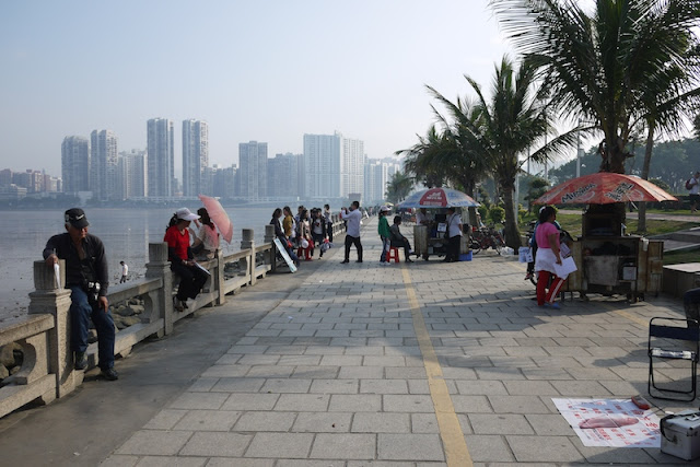 people in Zhuhai with Macau in background