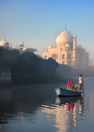 Two women on boat paddling on Yamuna River beside Taj Mahal. From The Big Trip: Your Ultimate Guide to Gap Years and Overseas Adventures