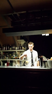 Bartender at Pépé Le Moko preparing a cocktail