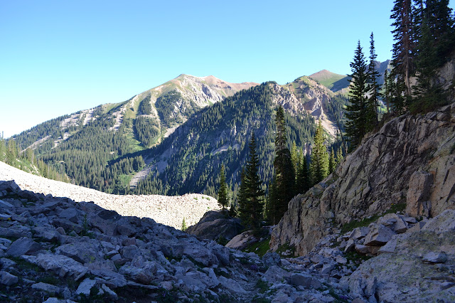 rocky section of trail with background peaks