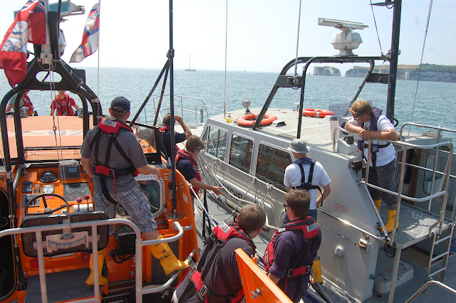 Poole lifeboat crew practising coming alongside a 'casualty' vessel Photo: RNLI Poole/Oli Mallinson