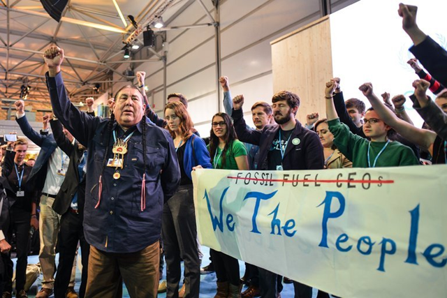 Demonstrators at a presentation by the United States delegation to the United Nations climate change conference in Bonn, Germany, on 13 November 2017. Photo: Philipp Guelland / European Pressphoto Agency