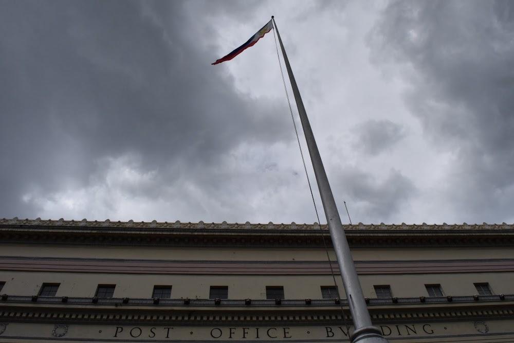 Philippine flag flies high above it