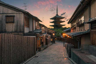 Photo: Scenic Serendipity || 風光明媚なセレンディピティ  During my trip to Kyoto last month, I had intended to shoot Kiyomizu Temple at sunset, only to find it closed at 6, much too early to shoot what I had planned. A bit disappointed, I headed back down the long path home, watching as the sunset become more colorful by the minute. Thankfully, the path back took me right down this road by the Yasaka Pagoda just as the mixture of colors, clouds and crowds (or lack thereof) was perfect for the shot. I suppose I'll take it if I must! I also have a new Photography Quick Tip up on my blog showing how I used split toning in creating this image, so be sure to check that out!  京都に行った時に清水寺から夕焼けの撮影をやるつもりだったけど、6時に閉まったんです。早すぎと思ったが、何もできないから残念な気持ちで帰り始めた。ありがたいに、ジャストなタイミングに帰り道が八坂神社を通りました。誰もいなかったし色と雲が合わせて、この写真を撮ることできました。清水寺から撮りたかったけど、これもいいでしょうね!  Blog: http://lestaylorphoto.com/sunset-at-the-yasaka-pagoda-in-kyoto/  #japan #travel #cooljapan #nikon #kyoto