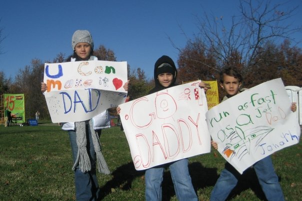 The kiddos with their homemade signs, cheering their Dad on to the finish :-)