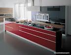 valcucine, cucina in vetro mod.artematica vitrum rossa, con isola con canale attrezzato e snack colazione