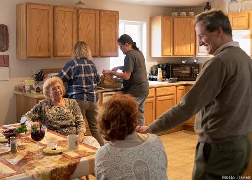 Mo, Melody and Robert, Deborah, and Bob carving the turkey