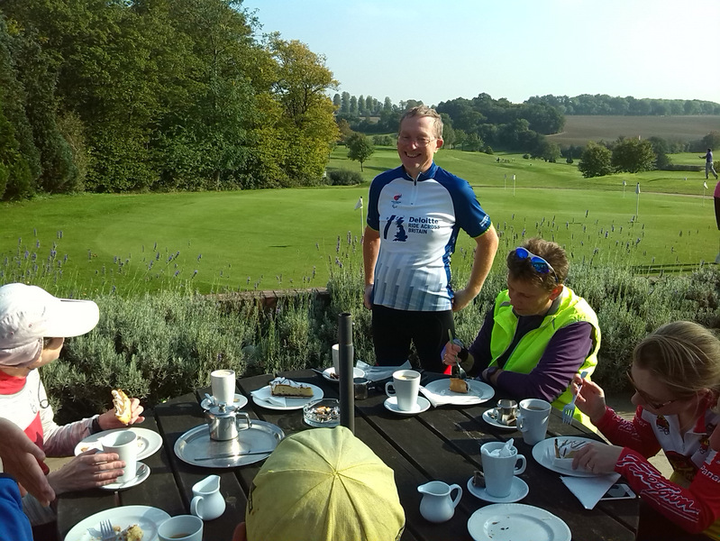 Group having tea at golf course