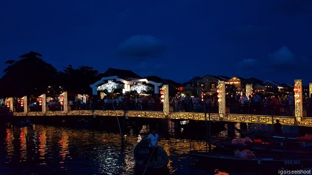 Crowded bridge across the river in Hoi An.
