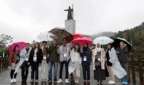 Soaking wet in the historic Admiral Yi Sun-sin Park in Tongyeong.