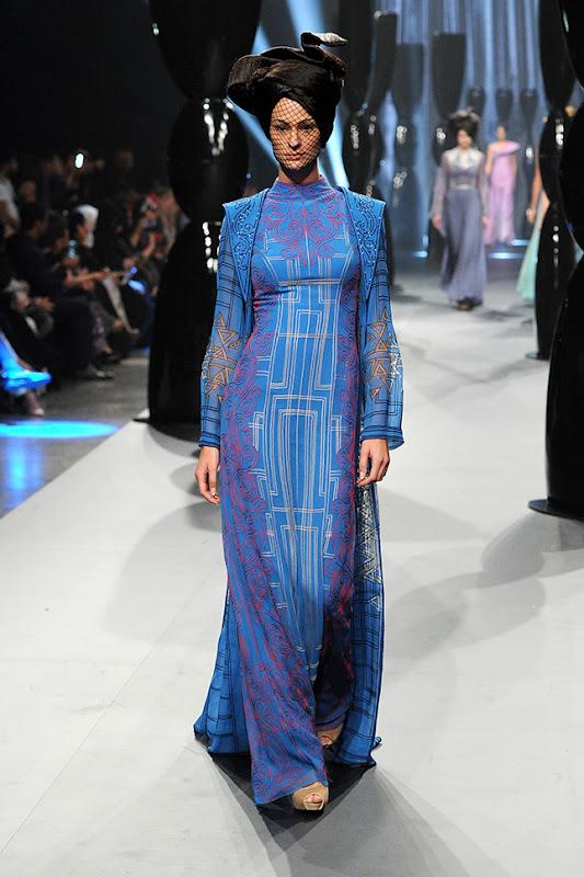 A model walks the runway at the Zareena show during Fashion Forward at Madinat Jumeirah on April 13, 2014 in Dubai, United Arab Emirates.