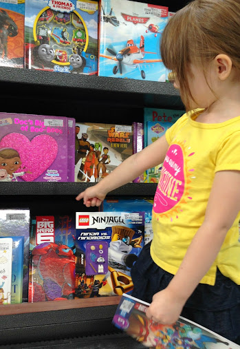 Choosing Big Hero 6 books at Walmart