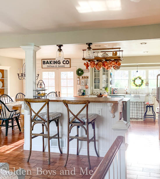 Farmhouse style kitchen in split level home with open floor plan - www.goldenboysandme.com