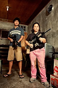 Assistants  My two assistants for my work in Manila holding plastic guns.