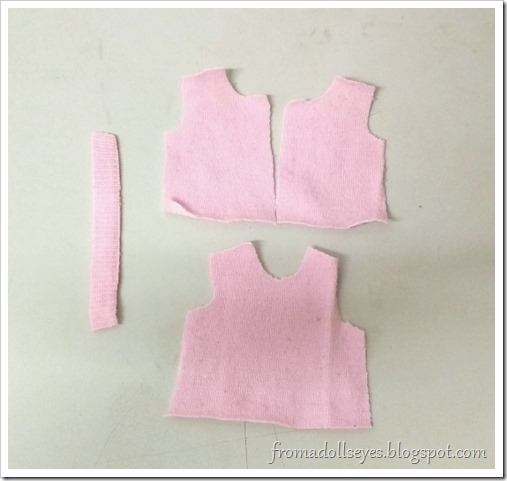 Cut out your pieces according to the sleeveless top pattern.  Use a cute sock or a light weight knit fabric.