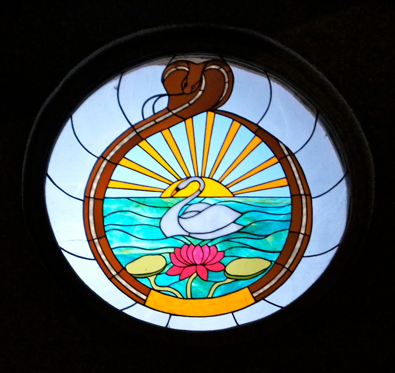 The seal of the Order, in stained glass, at night