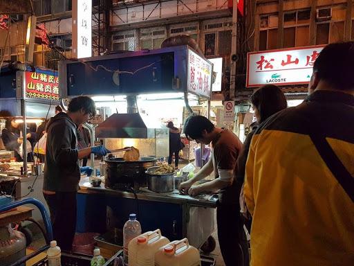 Okonomiyaki stall at Raohe Night Market in Taipei Taiwan