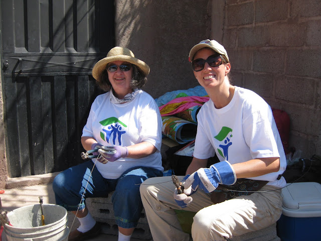 Amy E. Robertson and her mother Georganne cut construction wire while volunteering in Honduras with Habitat for Humanity. From Why and How to Volunteer When You Travel: Moon Volunteer Vacations in Latin America
