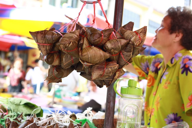 zongzi bak chang hanging on a street cart at chowrasta market in georgetown penang