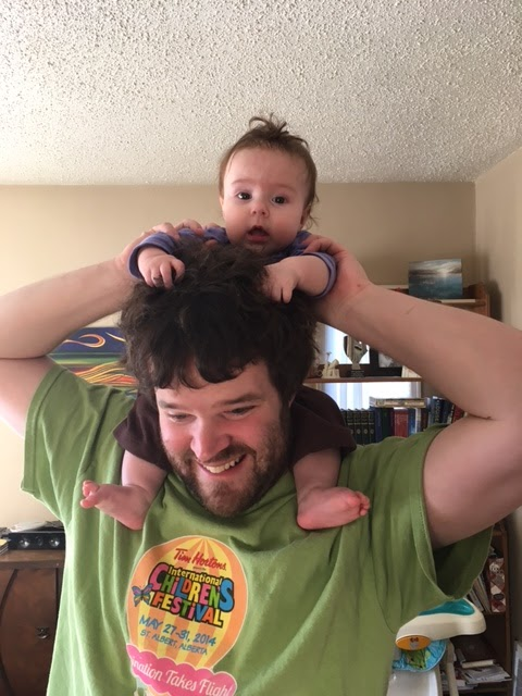 Cecilia enjoying her first shoulder ride