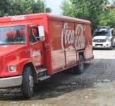 Encapuchados asaltan Coca Cola; roban más de RD$140,000