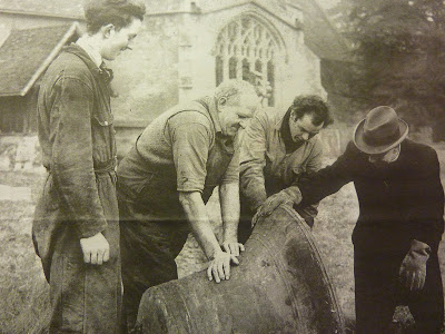 Examination of the church bells at Little Shelford in January 1961. Canon Edward Sibsob is on the right.