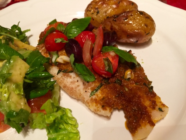 Basa with red pesto, basil and olives