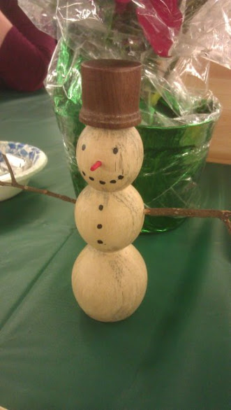 A cute little maple and walnut snowman