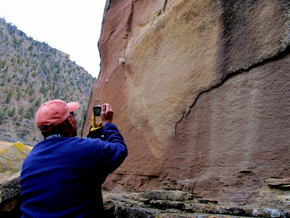 Alan photographing some very faint, large deer petroglyphs