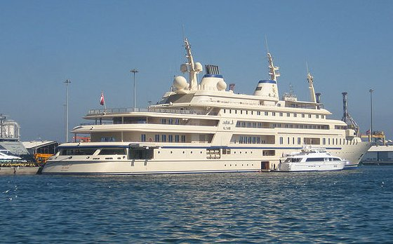 """The ship's name is al Said and the length is about 508 ft (155 meters). Its owner is Sultan Qaboos who is an avid fan and promoter of classical music. His 120-member orchestra has a high reputation in the Middle East. Although initially trained by British professionals, the orchestra consists entirely of young Omanis who audition as children and grow up as members of the symphonic ensemble. They play locally and travel abroad with the sultan (although not to Saudi Arabia, because the orchestra mixes male and female musicians).  Argentine composer Lalo Schifrin composed a work entitled 'Symphonic Impressions of Oman'. Such cultural innovations by the sultan have, however, been criticised as """"just wasted money"""" because, as one Omani professional observed in 2001, """"music diverts us from being serious about religion. (photo credit: www.vancouverinternationalboatshow.com/World's-largest-yachts.html)"""