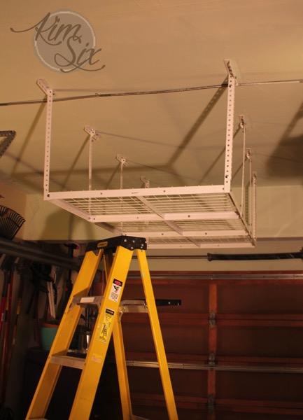 Installing suspended overhead garage storage rack