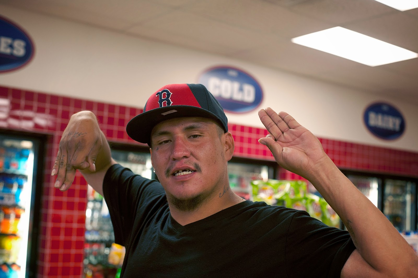 """Hardin, MT. Terrence Takes Enemy is Claiming """"Native Piru"""". This gang member flashes signs in a gas station. In Crow Agency there have been numerous gangs including teenagers that claim Blood or Crip."""