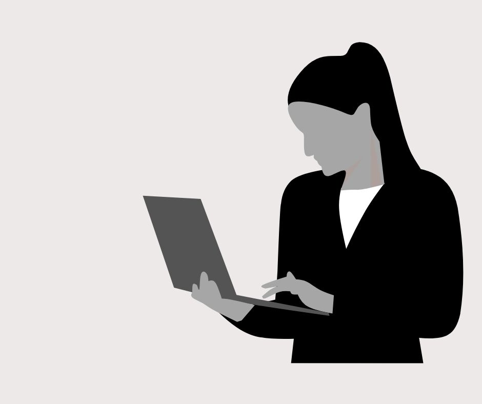 Woman typing on a laptop.