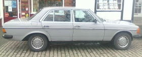 steel gray parked mercedes