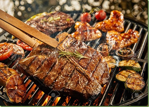 healthy lean t-bone steak grilling on a BBQ