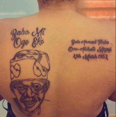 Lady Tattoos Bola Tinubu's Face, Name And Date Of Birth On Her Back (Photos)