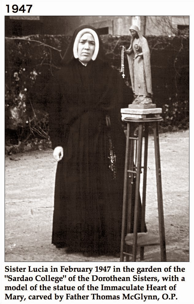 "Sister Lucia in February 1947 in the garden of the ""Sardao College"" of the Dorothean Sisters, with a model of the statue of the Immaculate Heart of Mary, carved by Father Thomas McGlynn, O.P."