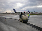 Fed Ex Terminal - Indianapolis Airport - Rolling out Asphalt Patching