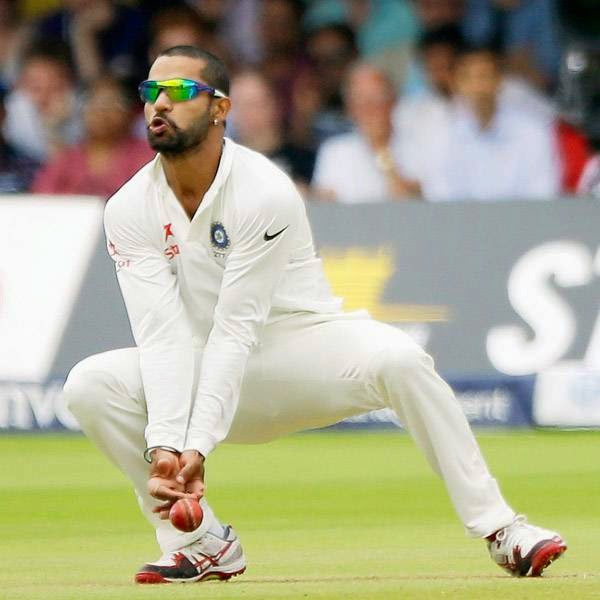 India's Shikhar Dhawan stops the ball at slip on the fifth day of the second cricket test match between England and India at Lord's cricket ground in London, Monday, July 21, 2014.