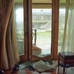 Broken window by debris
