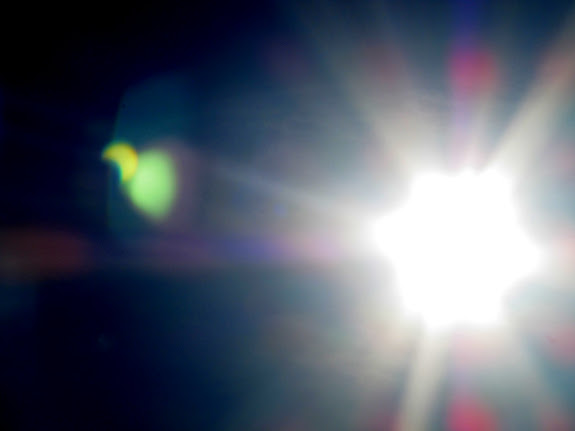 Lens flare showing the partial solar eclipse