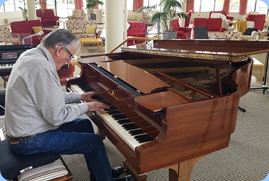 Roy Steen playing the Steinway grand piano.